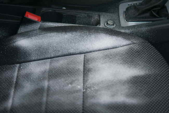 Close-up of dirty leather car seat