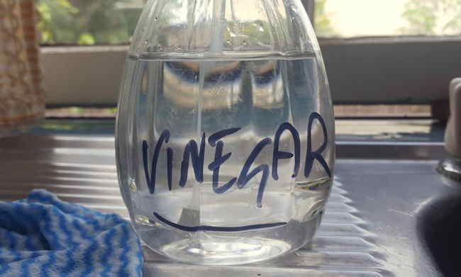 Bottle of homemade vinegar solution used to clean leather car seats